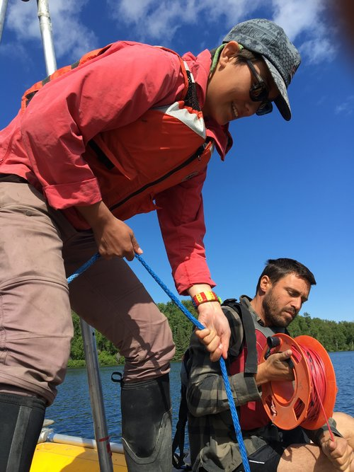 Annie Wong and David Fortin taking a Uwitec surface core at Sunken Island Lake