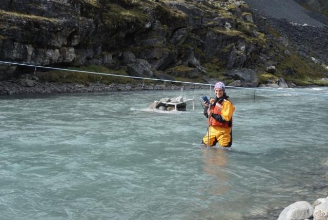 Ellie Broadman collecting discharge measurements in Carnnivore Creek