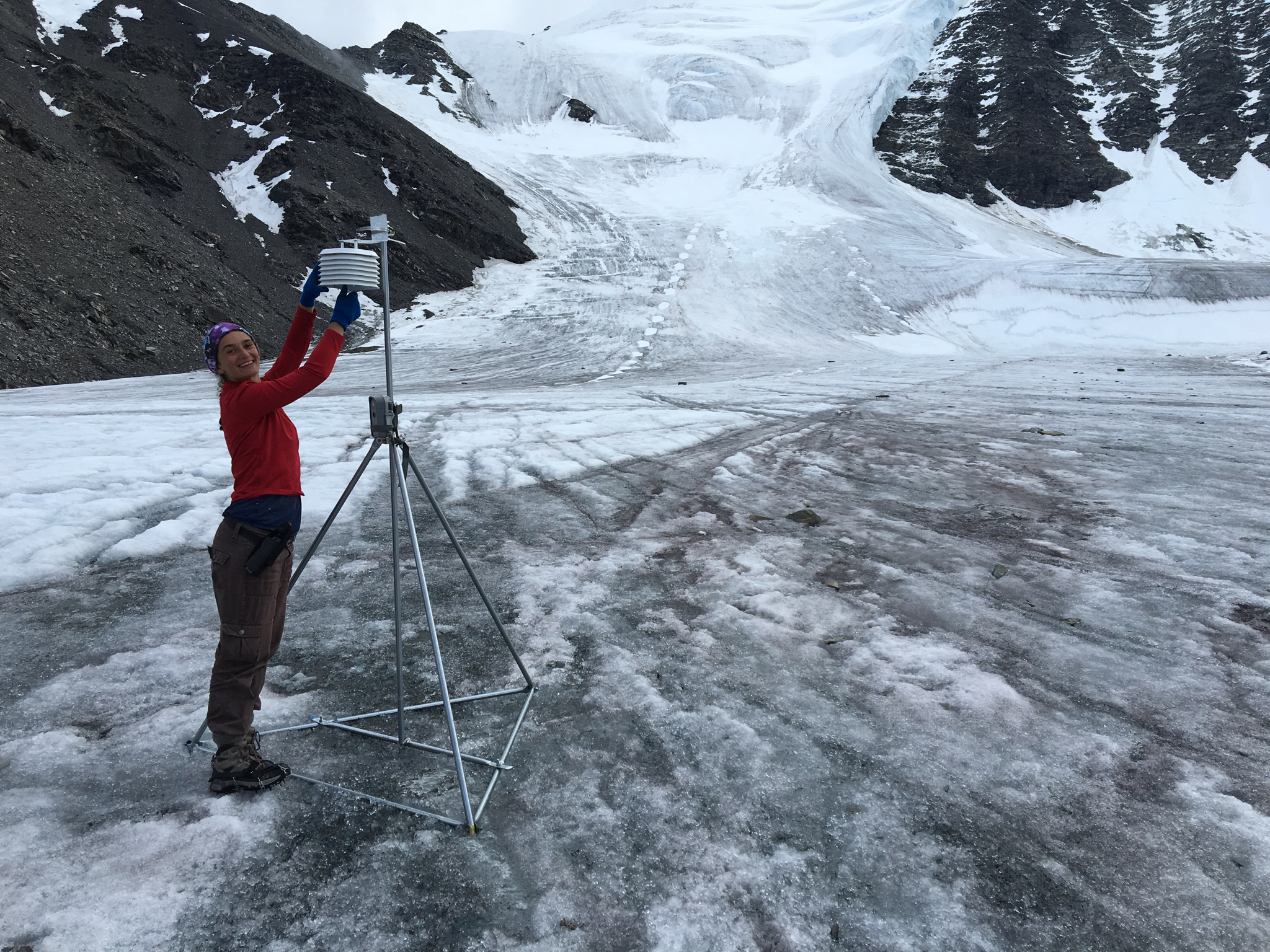 Ellie Broadman checks the weather station on Chamberlin Glacier