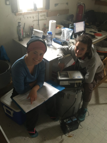Stephanie Arcusa and Ellie Broadman sample water at Lake Peters