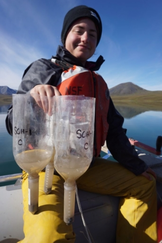 Stephanie Arcusa collects sediment traps from Lake Peters